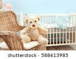 cute teddy bear on wicker... | Shutterstock . vector #588613985