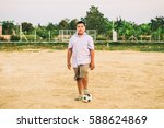 a fat boy playing soccer... | Shutterstock . vector #588624869