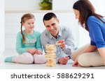 Happy Family Playing Jenga Gam...