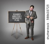 Small photo of Wander aimlessly without a plan text on blackboard with businessman