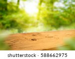 Wooden Table In A Sunny Spring...
