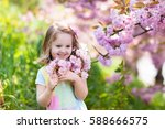 little happy girl playing under ... | Shutterstock . vector #588666575