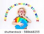 happy preschool child learning... | Shutterstock . vector #588668255