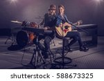 man and woman duo musician in... | Shutterstock . vector #588673325