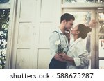Stock photo couple standing by the window in the morning 588675287