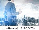 rear view of a businessman... | Shutterstock . vector #588679265