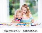 little boy and girl draw... | Shutterstock . vector #588685631
