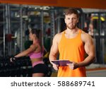 personal trainer holding... | Shutterstock . vector #588689741