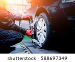 car mechanic installing sensor... | Shutterstock . vector #588697349