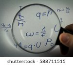 Small photo of The formulas in physics watching through a magnifying glass