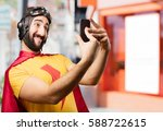 crazy super hero with mobile... | Shutterstock . vector #588722615