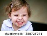 Lovely Little Girl Making Funn...