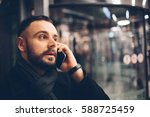 side view of young bearded man...   Shutterstock . vector #588725459