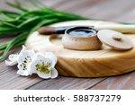 black substance in wooden jar... | Shutterstock . vector #588737279