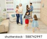 happy big family dancing in the ... | Shutterstock . vector #588742997