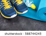yoga mat  sport shoes and... | Shutterstock . vector #588744245