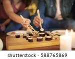 romantic date of couple eating... | Shutterstock . vector #588765869