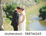 bride hugging groom at river | Shutterstock . vector #588766265