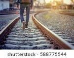 Man Walk Away On Railroad With...