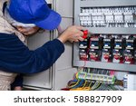electrician at work with an... | Shutterstock . vector #588827909