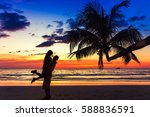 couple kissing on the beach... | Shutterstock . vector #588836591
