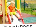 active little boy on playground.... | Shutterstock . vector #588843359