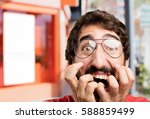 young crazy man scared... | Shutterstock . vector #588859499