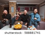 a company of four men having... | Shutterstock . vector #588881741