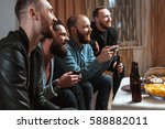 a company of four men having... | Shutterstock . vector #588882011