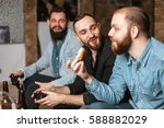 men with a beard sitting on the ... | Shutterstock . vector #588882029