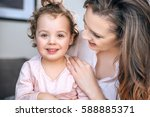 attractive young mother hugging ... | Shutterstock . vector #588885371