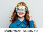 a woman happily smiling with... | Shutterstock . vector #588887411