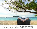 Lifestyle Young woman relaxing and happy on the summer beautiful luxury beach.  Summer and Lifestyle Concept - stock photo
