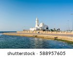 a white mosque located at... | Shutterstock . vector #588957605