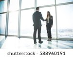 business people shaking hands... | Shutterstock . vector #588960191