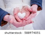 female and male hands with snow ...   Shutterstock . vector #588974051