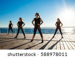 silhouettes of sportive girls... | Shutterstock . vector #588978011