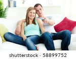 positive young couple sitting... | Shutterstock . vector #58899752