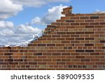 Crumbling Brick Wall With...