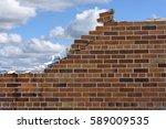Crumbling Brick Wall With...