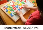 kid is learning the alphabets... | Shutterstock . vector #589014491