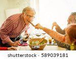 happy senior friends having... | Shutterstock . vector #589039181