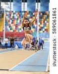 Small photo of ISTANBUL, TURKEY - DECEMBER 24, 2016: Athlete Seda Albayrak Long Jumping during Turkish Athletic Federation Indoor Athletics Record Attempt Races