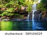 waterfall hidden in the... | Shutterstock . vector #589104029