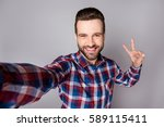 young funny smiling man... | Shutterstock . vector #589115411