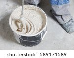mixing plaster solution in a... | Shutterstock . vector #589171589