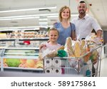 happy parents with child... | Shutterstock . vector #589175861