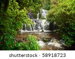 Cascading waterfall on the Purakaunui River in the South Island of New Zealand - stock photo