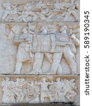 Small photo of TIRANA, ALBANIA - SEPTEMBER 27: Relief above the Council of Ministers glorifies socialist victory in all fields, Tirana, Albania on September 27, 2016.