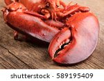 boiled lobster on wooden... | Shutterstock . vector #589195409